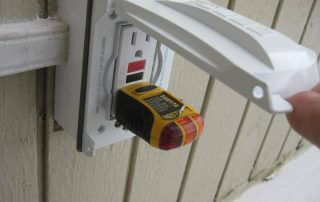 voltage meter in an outlet