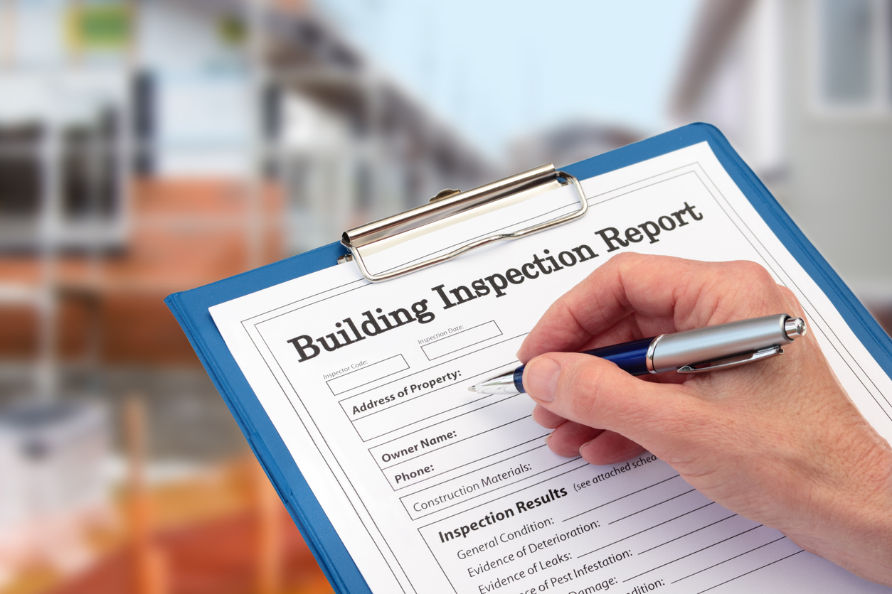 Buiding Inspector completing an inspection form