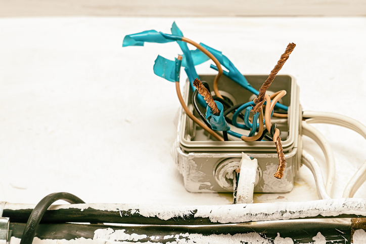 electrical box with damaged wires exposed